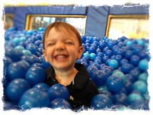 All smiles in the ball pit!